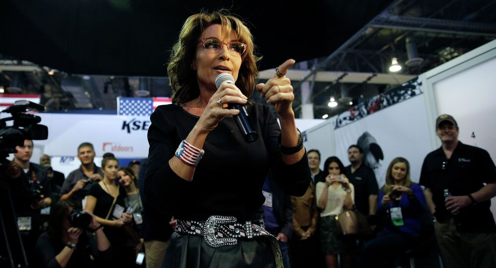 Former Alaska Gov. Sarah Palin speaks to a crowd during an event to promote her television show, Amazing America with Sarah Palin, at the Shooting, Hunting and Outdoor Trade Show, Thursday, Jan. 22, 2015, in Las Vegas