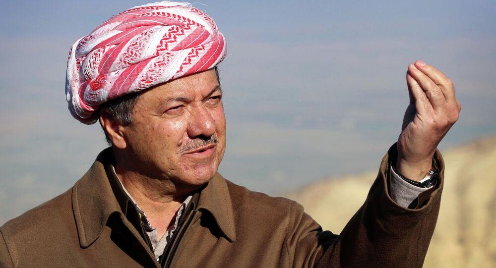 Iraqi Kurdish leader Masoud Barzani speaks to journalists on December 21, 2014
