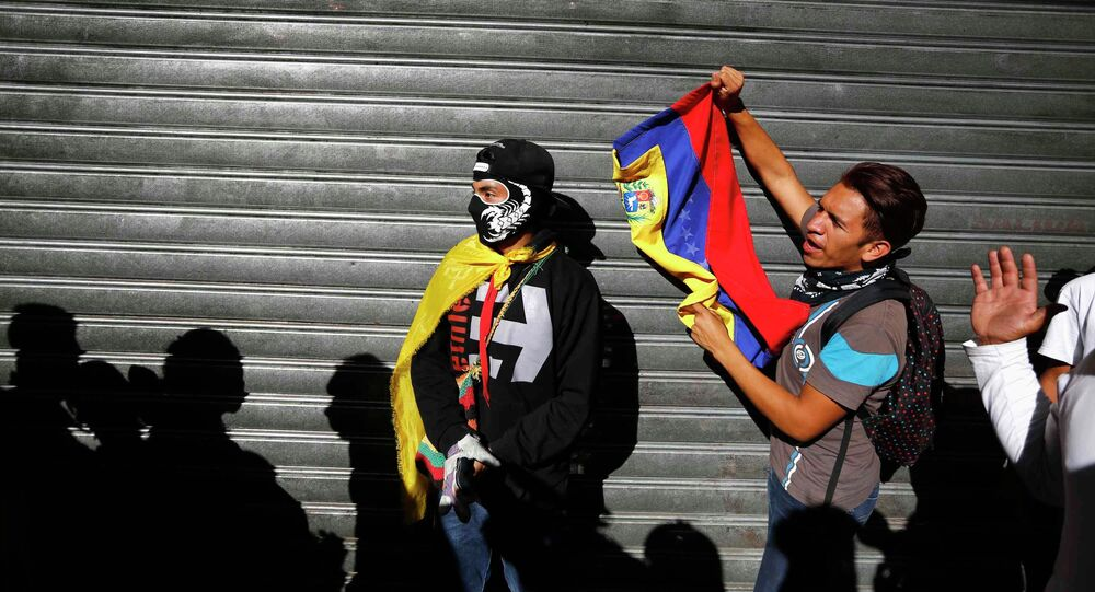 Demonstrators who support the opposition shouts slogans near people who were lining outside a supermarket to buy basic goods when it closed shortly for the day due to the ongoing protest in Caracas January 24, 2015