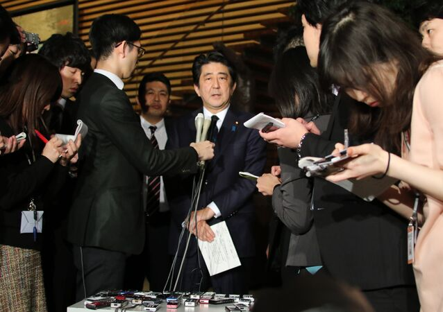 Japanese Prime Minister Shinzo Abe speakes to reporters after a cabinet meeting at his official residence in Tokyo on January 25, 2015