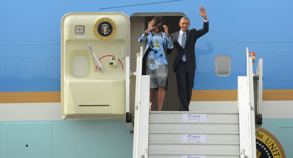 U.S. President Barack Obama and first lady Michelle Obama wave as they step out of Air Force One upon arrival at the Palam Air Force Station in New Delhi, India, Sunday, Jan. 25, 2015