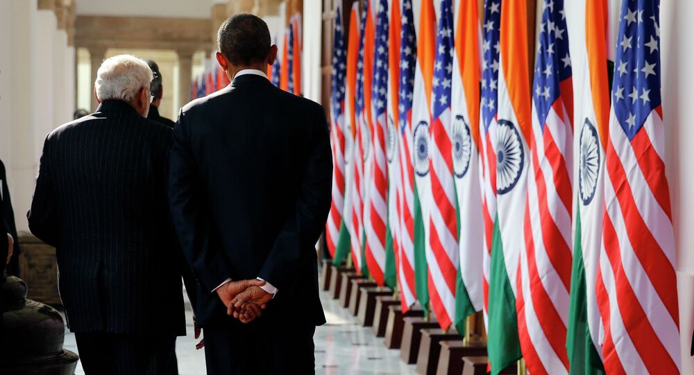 India's Prime Minister Narendra Modi and US President Barack Obama talk as they walk through Hyderabad House in New Delhi January 25, 2015