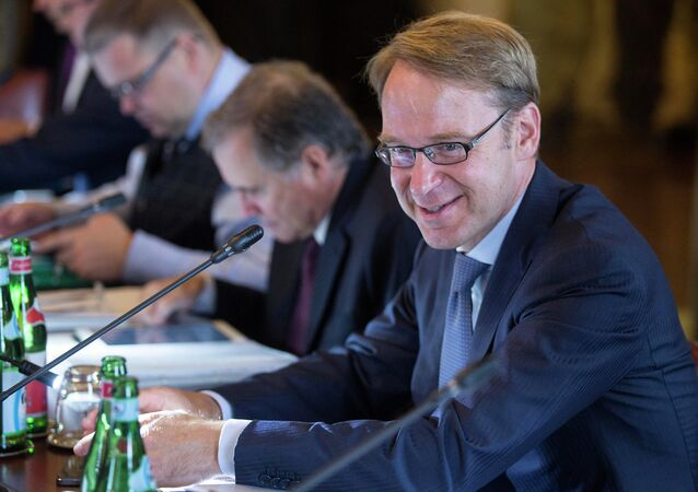 Bundesbank President Jens Weidmann smiles at the start of the ECB governing council meeting in Naples, Italy, Thursday, Oct. 2, 2014
