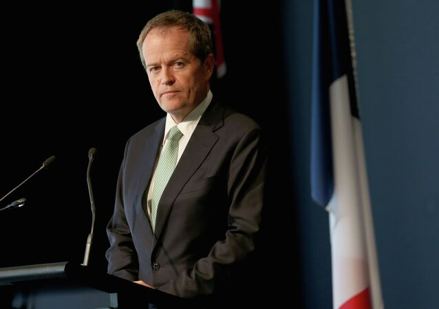 Leader of the Australian opposition, Bill Shorten, speaks to the media along with France's President Francois Hollande (not pictured) during a visit to the National Gallery of Australia in Canberra on November 19, 2014