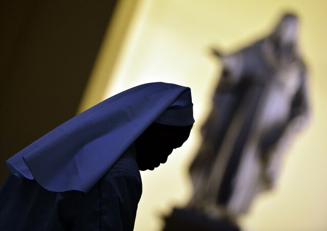 A nun walks in the hall of the Vatican's Gregorian University on November 13, 2012 in Rome