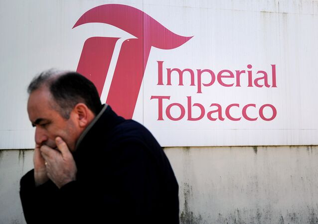 A man gives a phone call in front of the Seita-Imperial tobacco factory in Carquefou on April 15, 2014