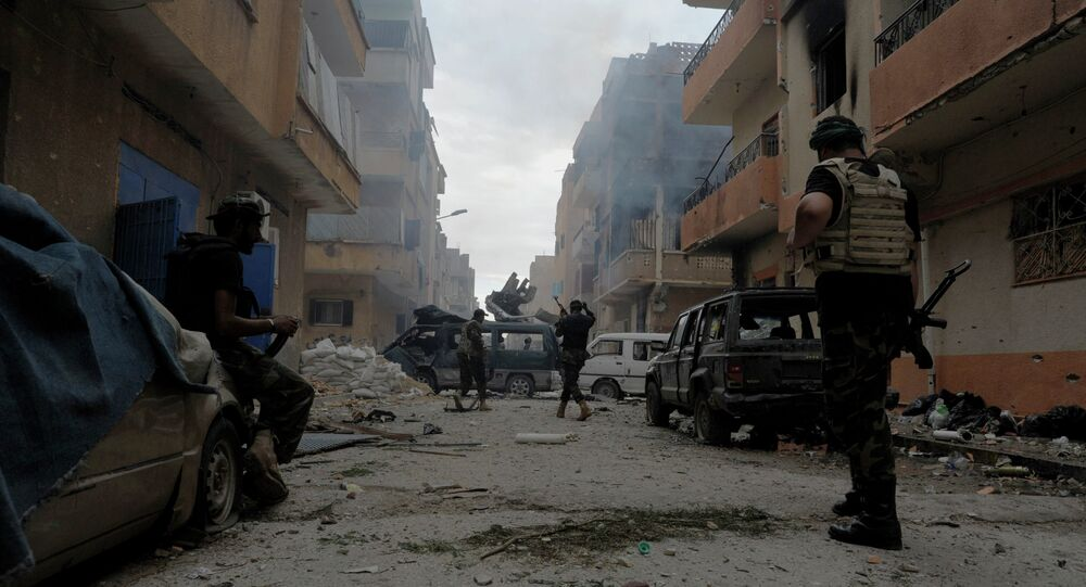 Libyan military soldiers check on an area as they battle with Islamic extremist militias in Benghazi