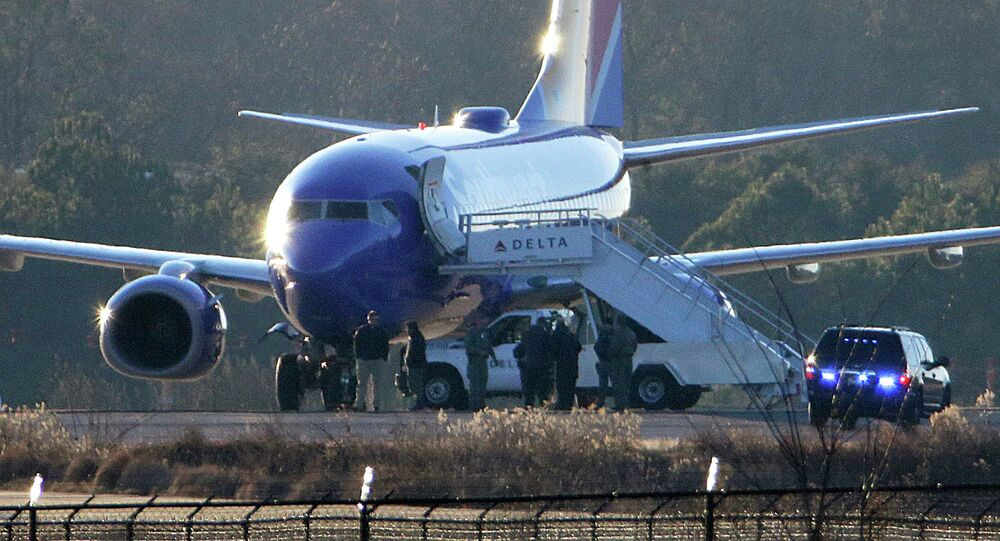 A commercial plane was evacuated and at least two others were diverted Sunday over security concerns, USA Today reports.