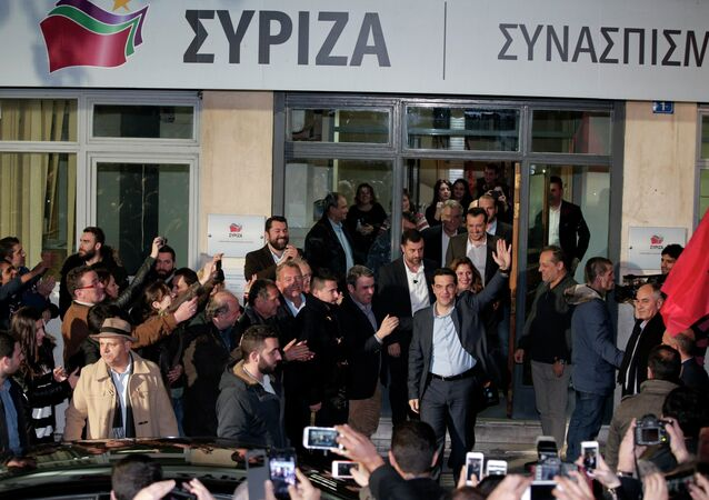 Leader of Syriza left-wing party Alexis Tsipras waves to supporters outside his party headquarters in Athens