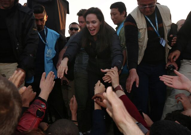 US actress and UNHCR ambassador Angelina Jolie (C) greets displaced Iraqi children during a visit to a camp for displaced people in Khanke, a few kilometres (miles) from the Turkish border in Iraq's Dohuk province