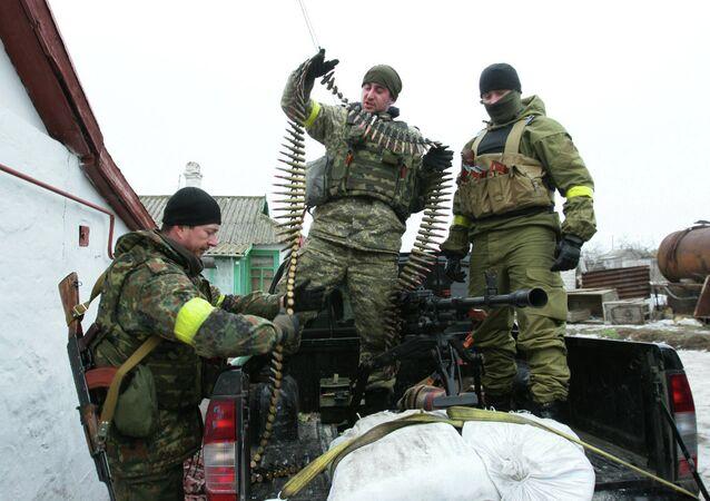 Ukrainian servicemen prepare their ammunition at a position on the frontline near the southern Ukrainian city of Mariupol on January 26, 2015.