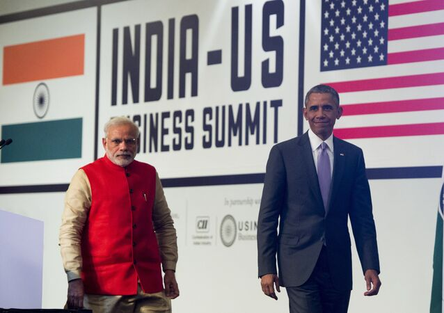Indian Prime Minister Narendra Modi (L) and US President Barack Obama leave after speaking during the India-US Business Summit in New Delhi on January 26, 2015.