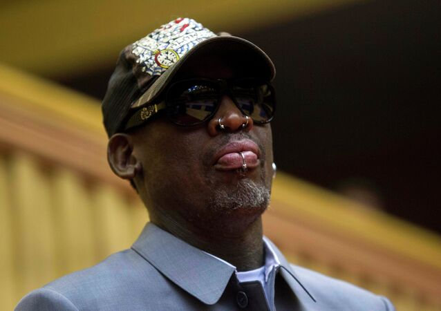 Dennis Rodman, looks out at the court at the end of an exhibition basketball game with U.S. and North Korean players at an indoor stadium in Pyongyang, North Korea