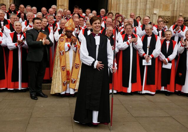 Libby Lane, the first female bishop in the Church of England, smiles following her consecration service at York Minster in York, northern England January 26, 2015