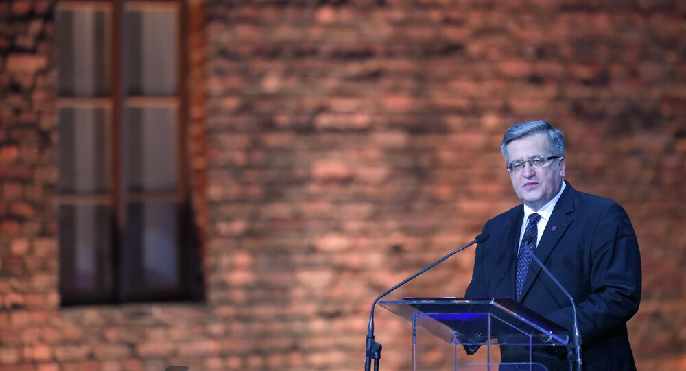Poland's President Bronislaw Komorowski delivers a speech at a tent erected in front of the entrance of the former Nazi concentration camp Auschwitz-Birkenau during the main ceremony to mark the 70th anniversary of the liberation of the death camp on January 27, 2015 in Oswiecim, Poland.