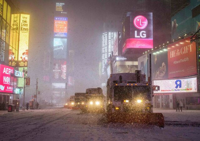 Snow plow trucks clear the roads during a snowstorm in Times Square, New York early morning January 27, 2015