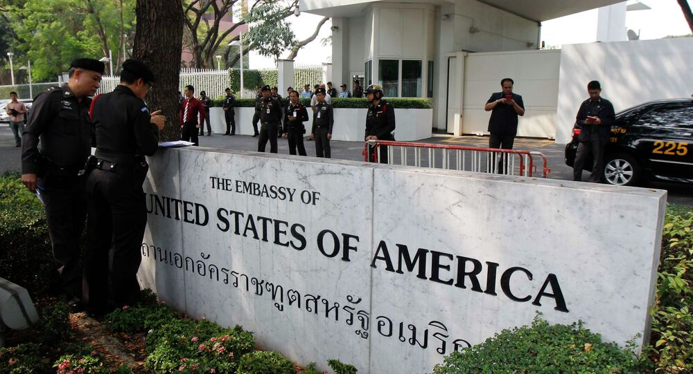 Police stand guard outside the US embassy in Bangkok January 28, 2015. Thailand warned the United States against meddling in its political affairs on Wednesday, saying many Thais had been hurt by the remarks of a visiting US envoy who took a swipe at the ruling military junta's undemocratic practices