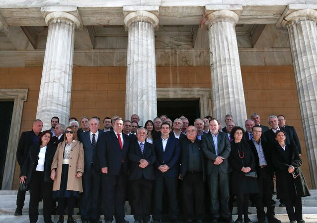 Greek Prime Minister Alexis Tsipras (front row C) and members of his government pose for a group picture after the first meeting of the new cabinet in the parliament building in Athens January 28, 2015.