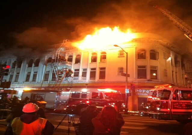 At least one person has died and four others have been hurt in a large building fire in San Francisco's Mission District, local media outlet Mission Local reported Thursday.