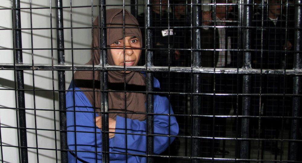Iraqi Sajida al-Rishawi stands inside a military court at Juwaida prison in Amman