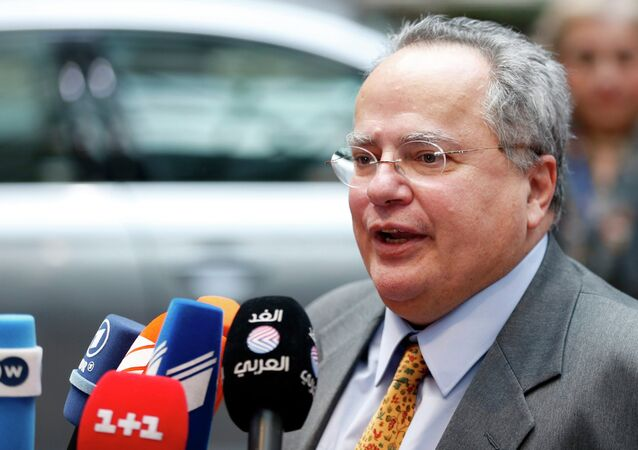 Greek Foreign Minister Nikos Kotzias talks to the media as he arrives at an extraordinary European Union foreign ministers meeting in Brussels January 29, 2015. Kotzias stoked a brewing row with European partners over sanctions against Russia on Thursday, saying Athens would not be pushed into agreement because of its impending debt negotiations.