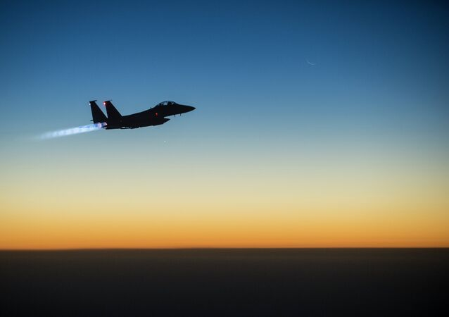 A U.S. Air Force F-15E Strike Eagle aircraft flies over northern Iraq