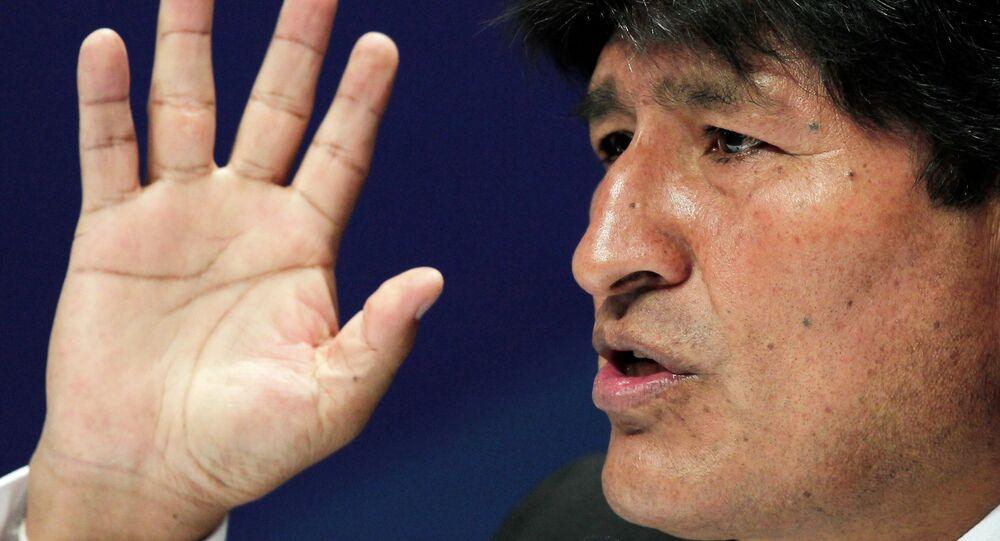 Bolivia's President Evo Morales gestures during a press conference at the Community of Latin American and Caribbean States (CELAC) summit in San Antonio de Belen Heredia province, January 29, 2015