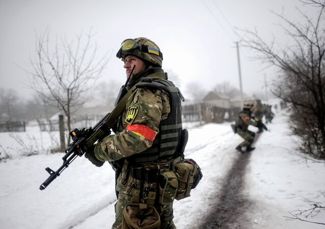 Ukrainian servicemen patrol Orekhovo village in Luhansk region January 28, 2015