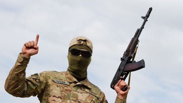 Aidar soldier pose for picture showing the islamic sign of faith - Sputnik International