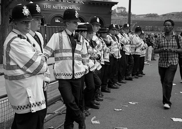 Britain police and a black man