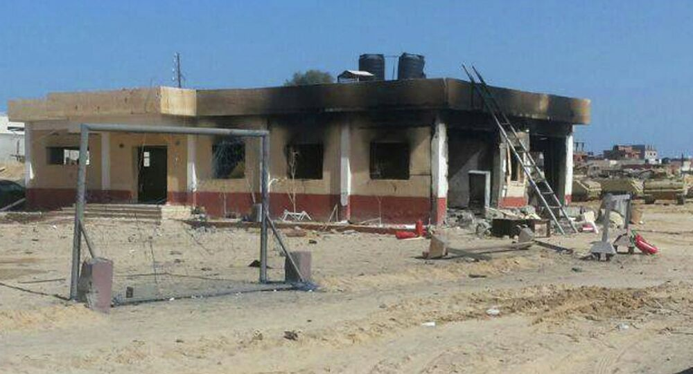 A damaged building is seen at a location where an attack took place on security forces in North Sinai, January 30, 2015