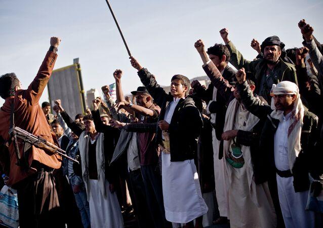 Houthi Shiite Yemenis chant slogans during a rally  in Sanaa, Yemen, Wednesday, January 28, 2015
