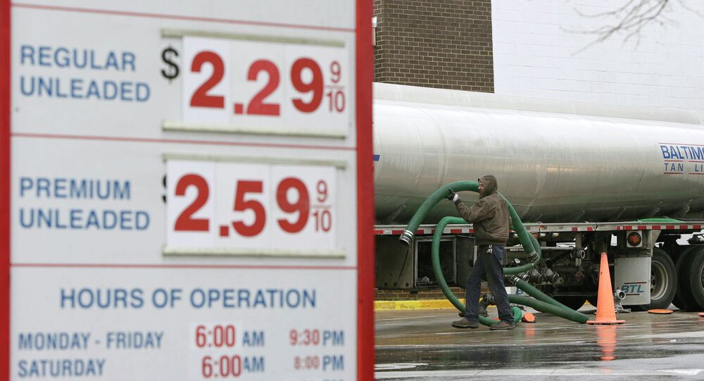 A fuel tanker truck driver stores his hoses after a gasoline delivery at the Costco in Beltsville, Maryland