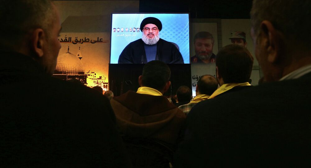 Hezbollah leader Sheikh Hassan Nasrallah, speaks via video link to his supporters