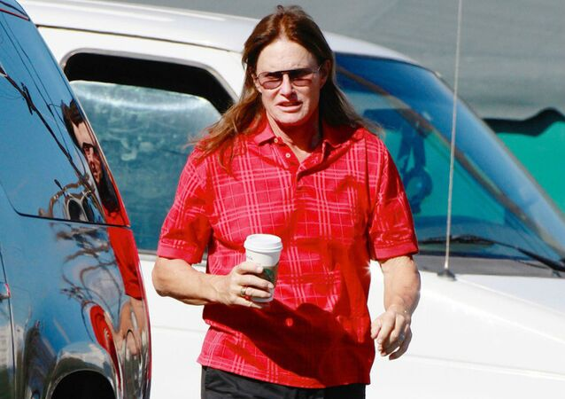 Bruce Jenner shows off his long hair as he takes his Polaris RZR for a journey to a repair shop in LA