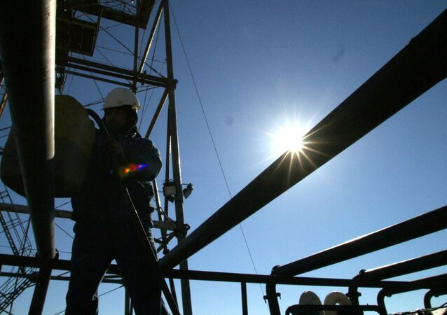Oil experts work at the Khabbaz productive site, 320 km north of Baghdad