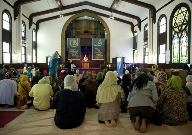 Muslim women kneel for the prayer service at the Women's Mosque of America in downtown Los Angeles, California January 30, 2015