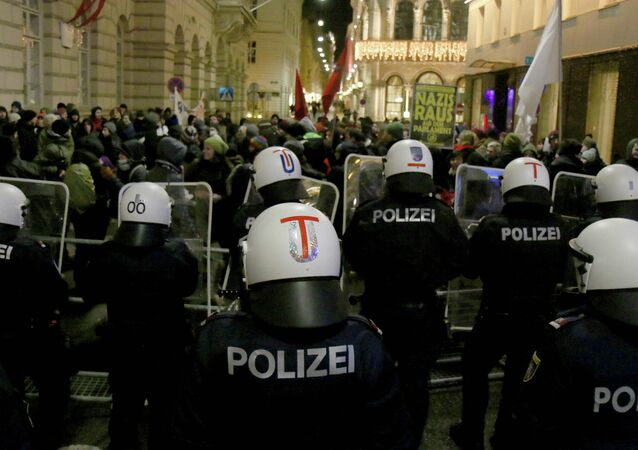 Demonstrators are stopped by police as they gather to protest against the ball at the Hofburg palace hosted by Austria's right-wing Freedom Party