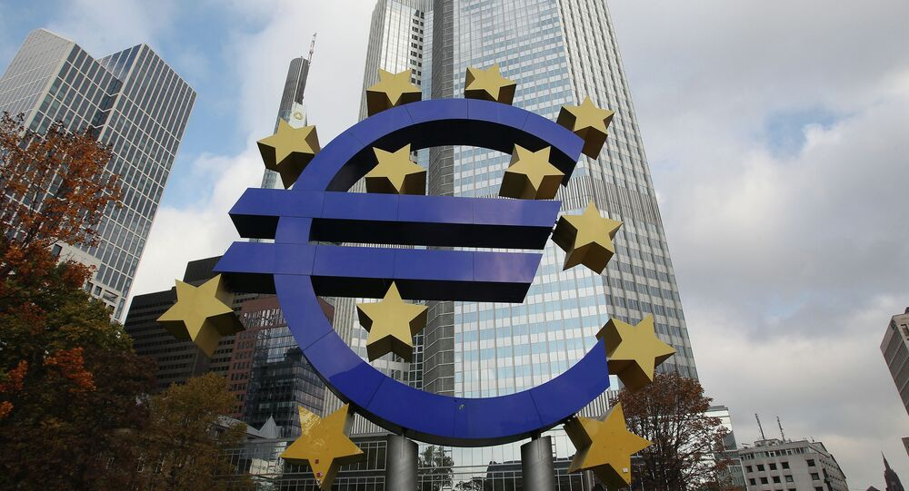 The EURO logo is pictured in front of the European Central Bank, ECB in Frankfurt/Main, central Germany, on November 6, 2014