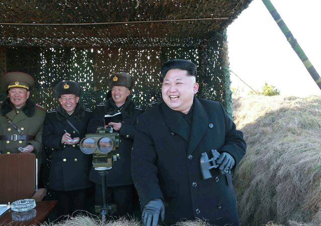 North Korean leader Kim Jong Un (R) laughs as he watches a drill by the Korean People's Army (KPA) for hitting enemy naval target at undisclosed location in this undated photo released by North Korea's Korean Central News Agency (KCNA) in Pyongyang January 31, 2015