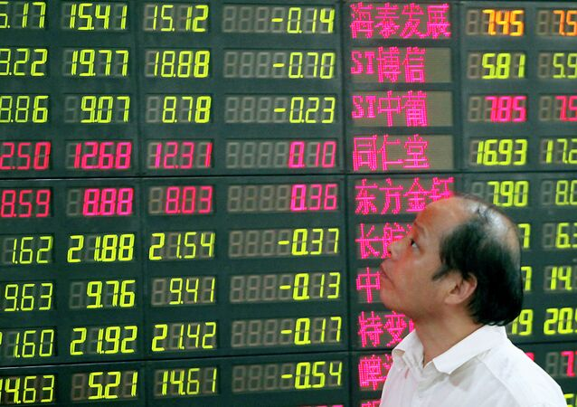 An investor looks at a stock price monitor at a private securities company