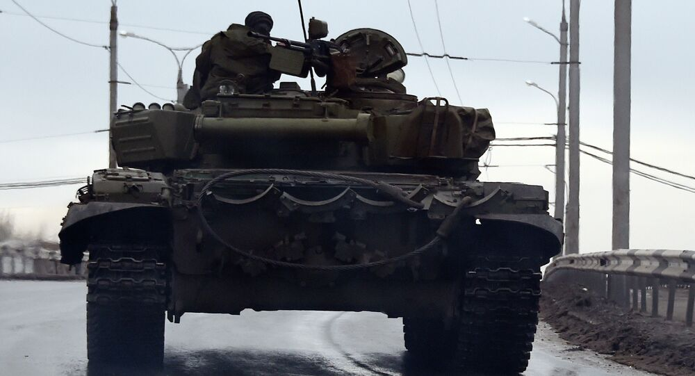 A tank drives in the center of the eastern city of Donetsk