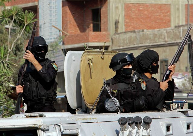Masked Egyptian security forces deploy in the Cairo suburb of Matareya on the day that Islamists called for nationwide demonstrations Friday, Nov. 28, 2014.