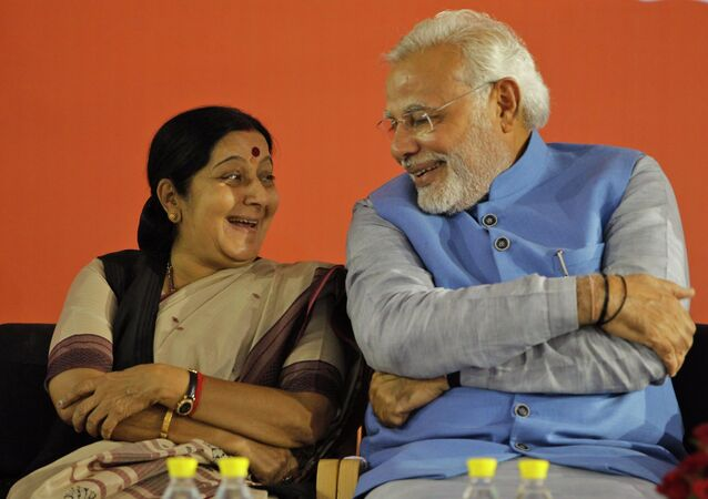 Opposition Bharatiya Janata Party (BJP) leader and India's next prime minister Narendra Modi, right, has a laugh with party leader Sushma Swaraj