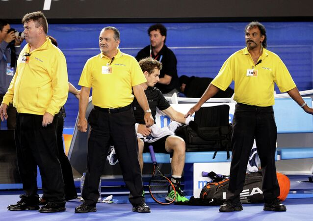 Andy Murray of Britain, center, is guarded by security guards as political protesters are taken away from Rod Laver Arena during his men's singles final against Novak Djokovic of Serbia