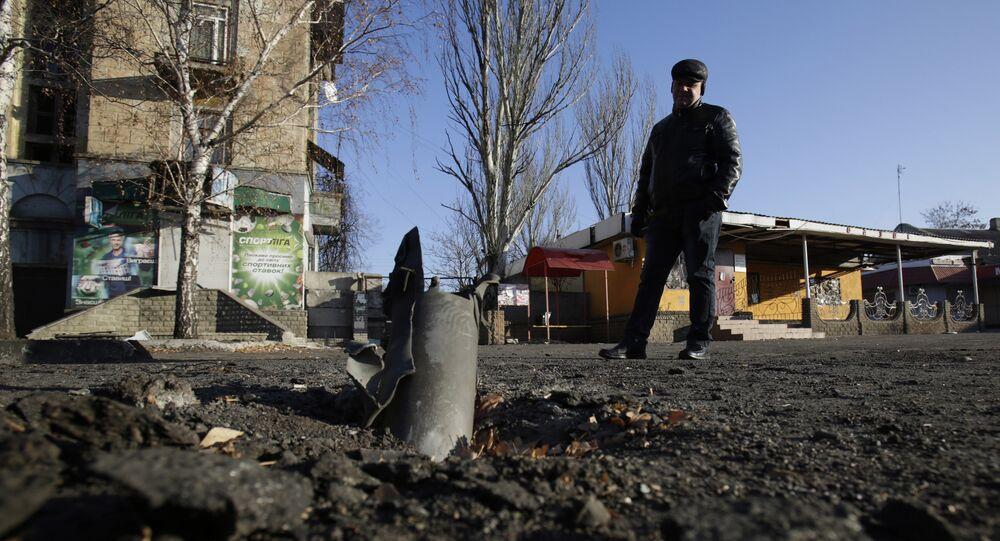 A man looks at Grad rocket launcher system after shelling November 23, 2014 in eastern Ukrainian city of Debaltseve