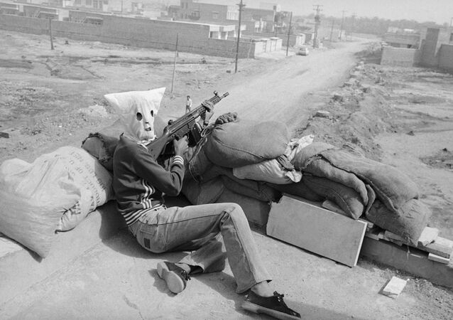 Hooded gunmen supporting Iran's central Islamic government, waiting on rooftop position in Khoramshahr, Iran on Friday, June 1, 1979