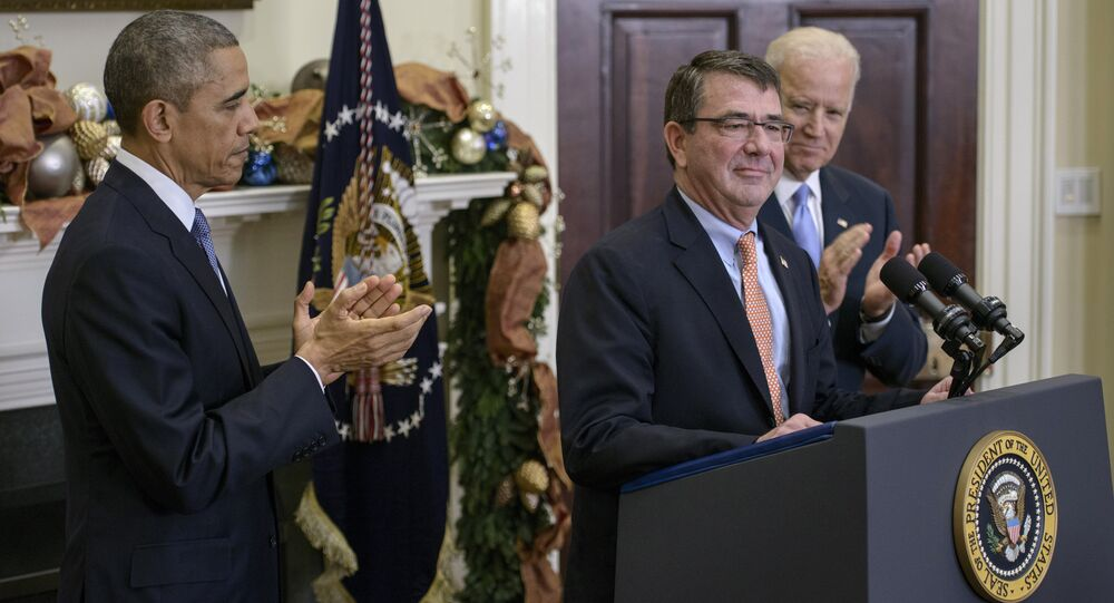 US President Barack Obama (L) and Vice President Joseph Biden (R) clap for Ashton Carter after nominating him for Secretary of Defense in the Roosevelt Room of the White House December 5, 2014 in Washington, DC