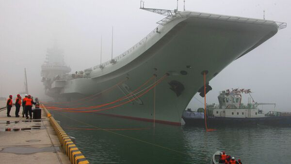China's first aircraft carrier, the Liaoning, is anchored in the northern port in Qingdao, east China's Shandong Province, Wednesday, Feb. 27, 2013 - Sputnik International