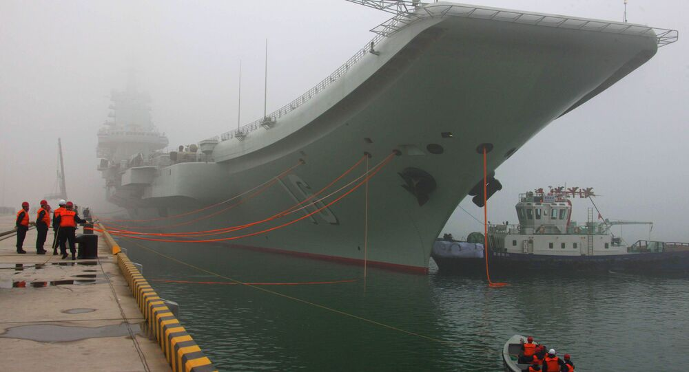China's first aircraft carrier, the Liaoning, is anchored in the northern port in Qingdao, east China's Shandong Province, Wednesday, Feb. 27, 2013